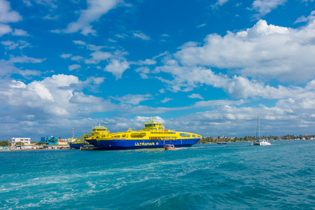 ISLA MUJERES, MEXICO, JANUARY 10, 2018: Outdoor view of huge boat of color blue and yellow sailing in the waters close to the Isla Mujeres . The island is some 7 kilometres long and 650 metres wide Editorial