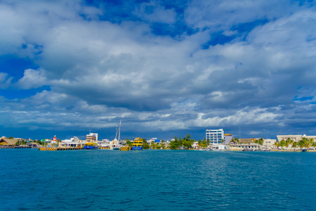 ISLA MUJERES, MEXICO, JANUARY 10, 2018: Beautiful outdoor view of military ship and some buildings in the horizont in Isla Mujeres, during a gorgeous day in Mexico
