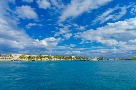 ISLA MUJERES, MEXICO, JANUARY 10, 2018: Beautiful outdoor view of some buildings in the horizont in the beach Isla Mujeres in caribbean sea, with a turquoise water in Mexico Editorial