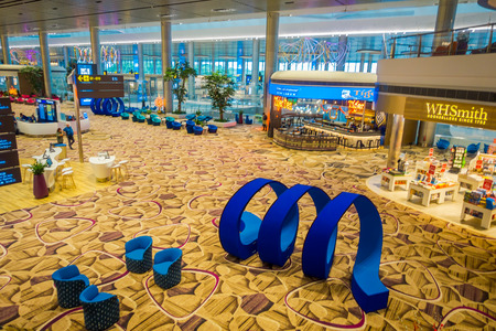 SINGAPORE, SINGAPORE - JANUARY 30, 2018: Above indoor view of beautiful blue abstract art located in a lounge area inside of Changi international airport