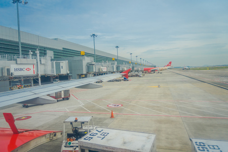 SINGAPORE, SINGAPORE - JANUARY 30, 2018: Outdoor view of air asia parking at Changi airport in Singapore. Changi Airport 42 million passengers a year, it is busiest airport in the world best asia airport Editoriali