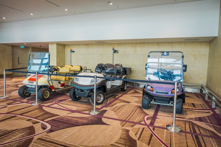 SINGAPORE, SINGAPORE - JANUARY 30, 2018: Interior view of three small cars parked in Changi Airport