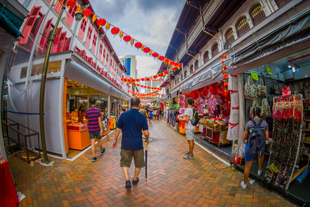 SINGAPORE, SINGAPORE - JANUARY 30. 2018: Outdoor view of people walking at public market The Lau Pa Sat festival market Telok Ayer is a historic Victorian cast-iron market building now used as a popular food court hawker center in Singapore, fish eye effe