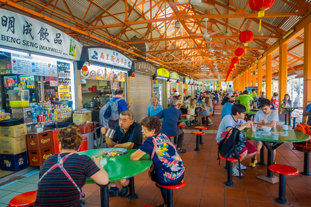 SINGAPORE, SINGAPORE - JANUARY 30. 2018: Indoor view of people eating in The Lau Pa Sat festival market Telok Ayer is a historic Victorian cast-iron market building now used as a popular food court hawker center in Singapore