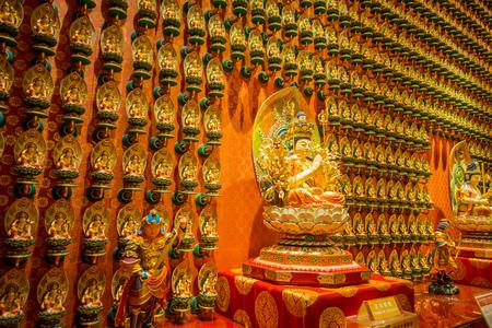 SINGAPORE, SINGAPORE - JANUARY 30. 2018: Buddha statue sitting on lotusDecorated Inside the Buddha Tooth Relic temple, Singapore near china town
