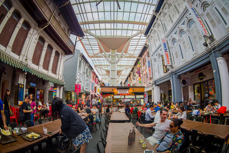 SINGAPORE, SINGAPORE - FEBRUARY 01, 2018: Indoor view of people eating in The Lau Pa Sat festival market Telok Ayer is a historic Victorian cast-iron market building now used as a popular food court hawker center in Singapore, fish eye effect