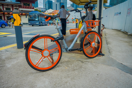 SINGAPORE, SINGAPORE - JANUARY 30. 2018: Outdoor view of shared bicycles in Singapore. The main bike sharing companies are Ofo, Mobike and Obike Editorial