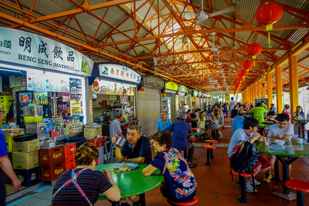 SINGAPORE, SINGAPORE - JANUARY 30. 2018: Unidentified people eating in The Lau Pa Sat festival market Telok Ayer is a historic Victorian cast-iron market building now used as a popular food court hawker center in Singapore Publikacyjne