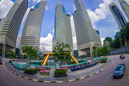 SINGAPORE, SINGAPORE - JANUARY 30. 2018: Beautiful outdoor view of fountain wealth with a public residential condominium building complex and downtown skylines at Kallang neighborhood in Singapore, fish eye effect