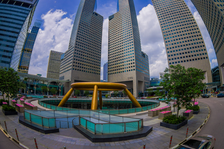 SINGAPORE, SINGAPORE - JANUARY 30. 2018: Outdoor view of fountain wealth with a public residential condominium building complex and downtown skylines at Kallang neighborhood in Singapore, fish eye effect Editöryel