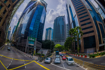 SINGAPORE, SINGAPORE - JANUARY 30. 2018: Outdoor view of public residential condominium building complex and downtown skylines at Kallang neighborhood with some cars in the streets of Singapore, fish eye effect