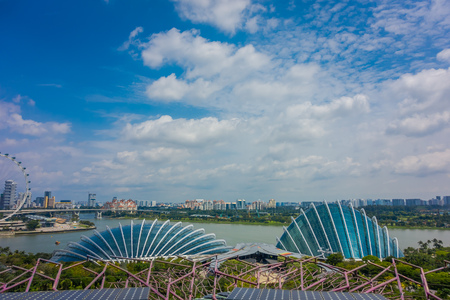 SINGAPORE, SINGAPORE - JANUARY 30, 2018: Above view of Cloud Forest Flower Dome at Gardens by the Bay in Singapore, with the largest Ferris Wheel in the World. Spanning 101 hectares of reclaimed land in central Singapore, adjacent to Marina Reservoir
