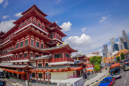 SINGAPORE, SINGAPORE - JANUARY 30, 2018: Outdoor view of huge red Buddha Tooth Relic Temple in China Town Singapore Editorial