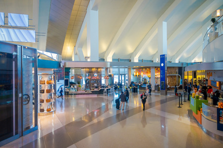 LOS ANGELES, EEUU, JANUARY, 29, 2018: Unidentified people walking close to many stores inside of the airport of the Los Angeles International Airport LAX , the primary airport serving the Greater Los Angeles Area