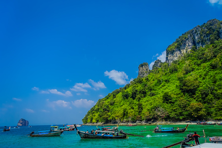 AO NANG, THAILAND - MARCH 05, 2018: Outdoor virw of many long tail boat in Thailand, standing on Chicken island in a gorgeous sunny day and turquoise water 報道画像