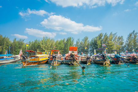 Outdoor view of Fishing thai boats in a row in Po-da island, Krabi Province, Andaman Sea, South of Thailand