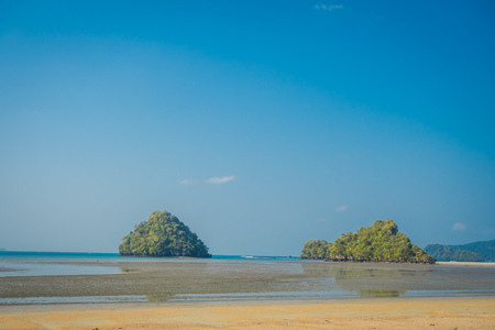 Beautiful landscapoe of two mountains in the horizont in the chicken beach at Andaman Sea, South of Thailand