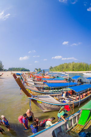 AO NANG, THAILAND - MARCH 05, 2018: Above view of fishing thai boats at the shore of Po-da island, Krabi Province, Andaman Sea, South of Thailand