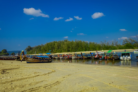 AO NANG, THAILAND - MARCH 05, 2018: Outdoor view of Fishing thai boats in a row at the shore of Po-da island, Krabi Province, Andaman Sea, South of Thailand