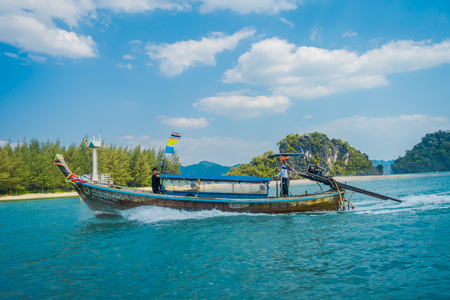 AO NANG, THAILAND - MARCH 05, 2018: Outdoor view of Long tail boat in Thailand, sailing on Chicken island in a gorgeous sunny day and turquoise water