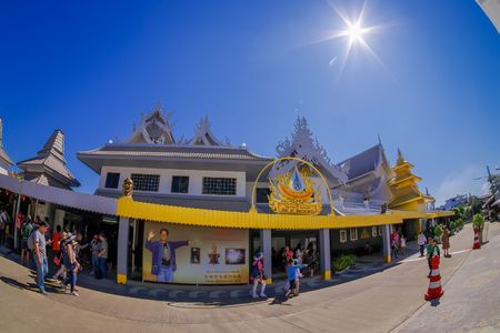 CHIANG RAI, THAILAND - FEBRUARY 01, 2018: Outdoor view of unidentified people walkingat the enter of white temple, in Chiang Mai Editorial