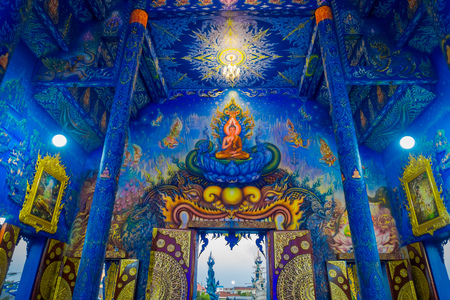 CHIANG RAI, THAILAND - FEBRUARY 01, 2018: Indoor view of the temple at Wat Rong Suea Ten, with beautiful colors and paints in the roof, walls inside of blue temple