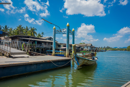 AO NANG, THAILAND - FEBRUARY 19, 2018: Beautiful outdoor view of long tail fishing boat close to a old buildings located in the river in fish farms at pier at Krabi Province, South of Thailand 報道画像
