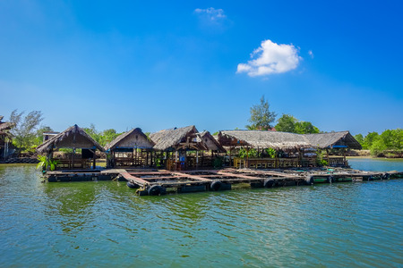 AO NANG, THAILAND - FEBRUARY 19, 2018: Outdoor view of traditional Thai seafood restaurant on stilts over the water in Krabi, Thailad