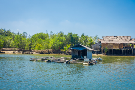 Outdoor view of old and damaged house floating in the river close to the mangroves in Krabi Province, South of Thailand 写真素材