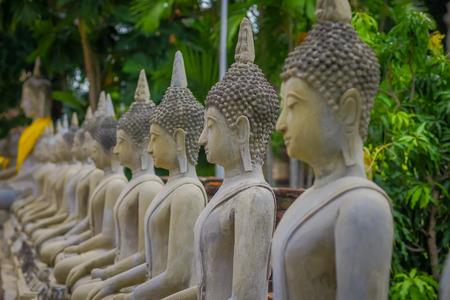 Close up of selective focus Ancient Buddha Statue at WAT YAI CHAI MONGKOL, The Historic City of Ayutthaya, Thailand Stock Photo