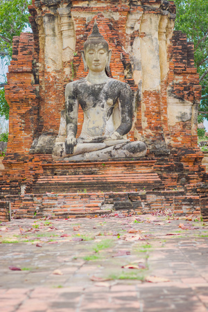 Outdoor view of the ancient budha at Ayutthaya Historical Park in the ruins of the old city