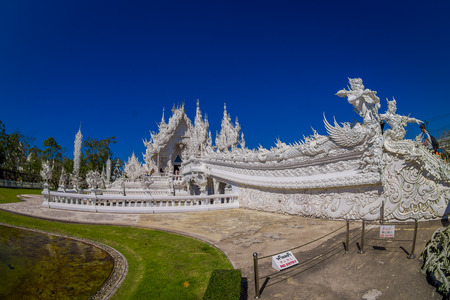 Beautiful ornate white temple located in Chiang Rai northern Thailand. Wat Rong Khun White Temple , is a contemporary unconventional Buddhist temple.Buddhist and Hindu motifs