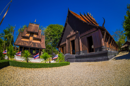 People an the enter of Baan Dam Museum Black House , one of the famous place and landmark in Chiang Rai province, Thawan Duchanee who pass away he is the famous artist in Thailand Stock Photo