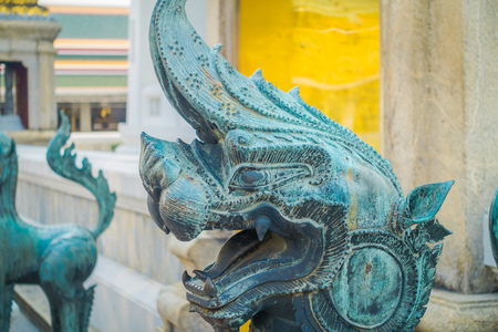 Close up of stone dragon statue located at the enter of Pranon Wat Pho, laying Buddha temple