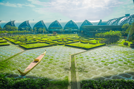 Beautiful outdoor view of relaxing park located at Suvarnabhumi Airport is the worlds third largest single-building airport terminal in Bangkok, Thailand Stock Photo