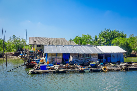 Outdoor view of very old and damaged house floating in the river located at fish farms in Krabi Province, South of Thailand