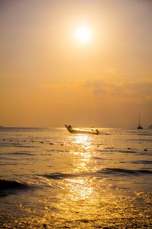 Beautiful outdoor view of fishing thai boats during a sunset at Po-da island, Krabi Province, Andaman Sea, South of Thailand 写真素材