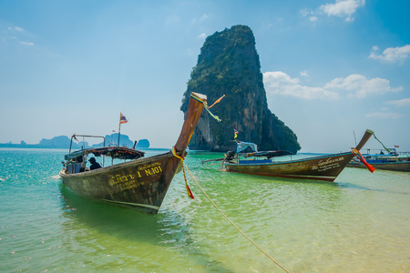 PHRA NANG, THAILAND - FEBRUARY 09, 2018: Long tail boats in a shore on Phra nang island in a gorgeous sunny day and turquoise water