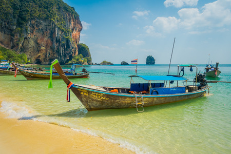PHRA NANG, THAILAND - FEBRUARY 09, 2018: Outdoor virw of long tail boats in a shore on Phra nang island in a gorgeous sunny day and turquoise water