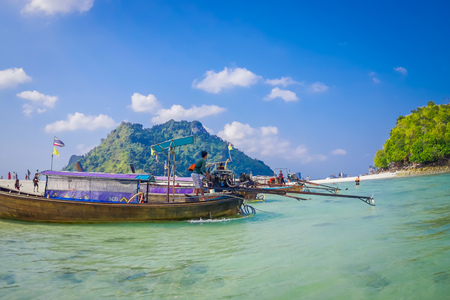 TUP, THAILAND - FEBRUARY 09, 2018: Beautiful outdoor view of long tail boats in a shore on Tup island in a gorgeous sunny day and turquoise water Editorial