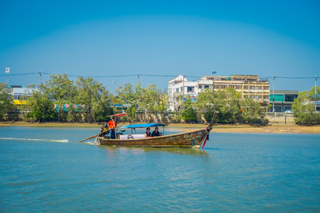 AO NANG, THAILAND - MARCH 05, 2018: Outdoor view of unidentified people traveling in Fishing thai boats in the river at Krabi Province, Andaman Sea, South of Thailand