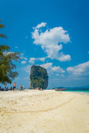 PODA, THAILAND - FEBRUARY 09, 2018: Outdoor view of unidentified people enjoying the sunny day and the turquoise water on Poda island
