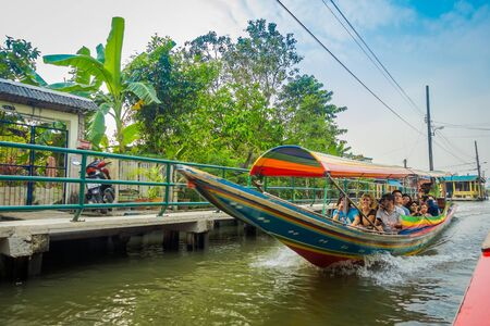 BANGKOK, THAILAND - FEBRUARY 09, 2018: Outdoor view of unidentified tourists at long-tail boat in Bangkok yai canal or Khlong Bang Luang Tourist Attraction in Thailand