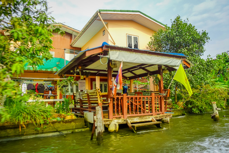 Outdoor view of gorgeous floating wooden house on the Chao Phraya river. Thailand, Bangkok Stock fotó
