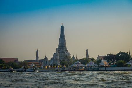 Amazing outdoor view of wat Arun Bangkok Thailand, the Temple of Dawn, on The Chao Phraya river in the horizont 写真素材