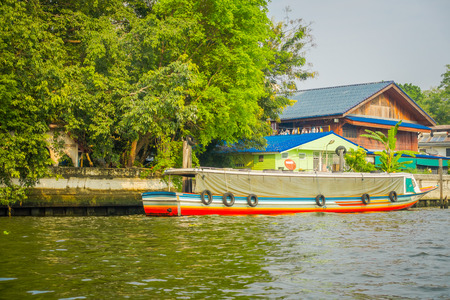 Long-tail boat parked in a riverside in Bangkok yai canal or Khlong Bang Luang in Thailand Stock Photo