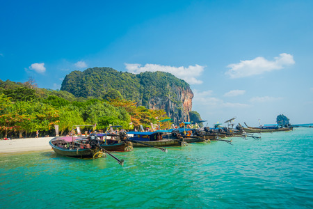 PHRA NANG, THAILAND - FEBRUARY 09, 2018: Beautiful view of long tail boat in a row in Thailand, standing on Phra nang island in a gorgeous sunny day and turquoise water 報道画像