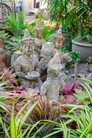 Backyard Statues close up of small budha statues in a backyard of a house at chiang