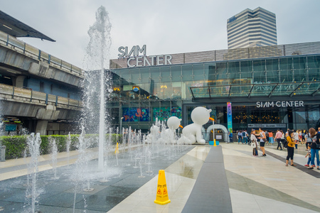 BANGKOK, THAILAND, FEBRUARY 02, 2018: Outdoor view of unidentified people with a fountain at the enter of Siam Paragon Shopping mall in Bangkok, It is one of the biggest shopping centres in Asia