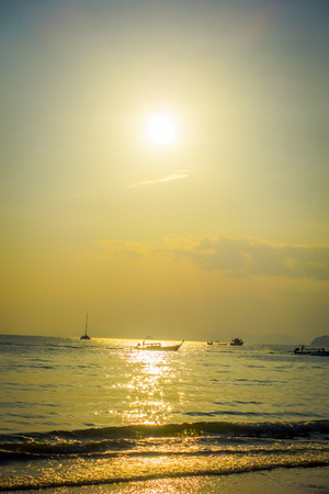 Beautiful outdoor view of fishing thai boats during a sunset at Po-da island, Krabi Province, Andaman Sea, South of Thailand Stock Photo